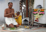 The shaman gives some leaves and ashes to be boiled and drunk at home. Tirunelveli District, Tamil Nadu.