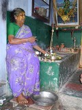 Diviner with offerings for the Gods on her altar. Tirunelveli District, Tamil Nadu.