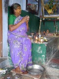 Diviner praying to the Gods, before she starts a ceremony. Tirunelveli District,n Tamil Nadu.