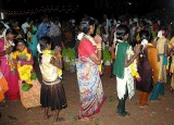 Finally the women dance in a circle around the Mulaipari pots. Mulaipari festival at Koovathupatti Tamil Nadu.