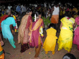 Finally the women dance in a circle around the Mulaipari pots. Mulaipari festival at Koovathupatti, Tamil Nadu.
