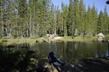 Crossing the gentle outlet of Tenaya Lake