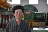 jovial worker in fertilizer factory
