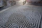 Mosiac tiled floor in the bath house