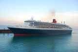 Queen Mary 2 docked beside us in Rome