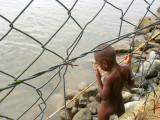 Little boy fishing just outside the hotel grounds