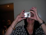 'H' taking a photo