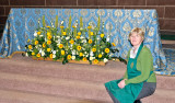 Nave altar flowers and one of the arrangers