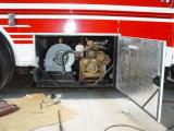 A SWING OPEN DOOR WAS ADDED FOR EASY ACCESS TO THE FLUID LEVELS AND BELT, WITHOUT HAVING TO SLIDE THE GENSET DRAWER OUT