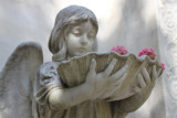 girl statue with flowers