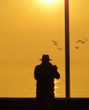 A photographer at sunrise....