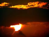 Le soleil sous les nuages