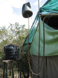 Tent camp shower behind the scenes