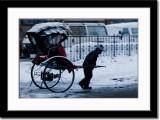 Riksha Driver in A Snow Storm