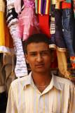 Framed by his wares Jamnagar.jpg