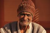 Patan man with hat.jpg