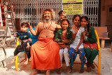 Ahmedabad temple priest with children.jpg