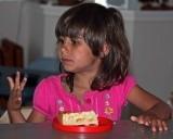 Maya enjoying her lemon cake