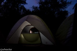 Vaughn in his tent downloading pictures