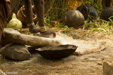 Grinding maize on a stone.
