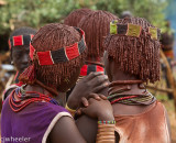 Girls with the red ochre in their hair.