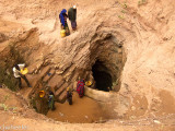 Singing well. Women bringing up water from a well deep underground