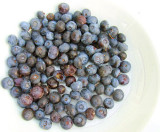 Berries on the turn on a white plate