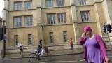 Biker, pedestrians and building Cambridge