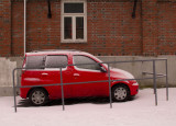 Fenced Red car Nils Ankersgt. 3