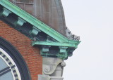 Peregrine pair perched; one ledge north clock face; other NW corner