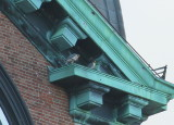 Peregrine pair on west ledge diag. above north clock face