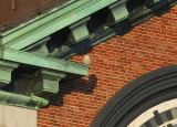 Peregrine on ledge; diag./above to left of east clock face