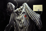 German Concentration Camp uniform with red triangle of a political prisoner with R for Russian