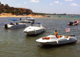 Boats waiting to ferry people across the bay to Ilha do Mussulo