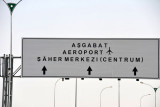 Road sign for Ashgabat Airport and the City Center