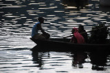 Man paddling a canoe on Lake Phewa, Pokhara