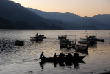Boats on Lake Phewa in the evening