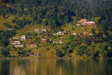Traditional houses and terraced fields on the opposite shore of Lake Phewa