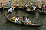 Sampan setting across the river off with five passengers while the other wallahs wait patiently