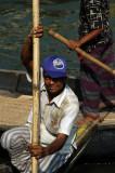 Dhaka sampan wallah...a fan of the St. Louis Rams, Bangladesh