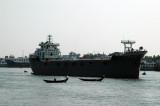 Medium sized freighter riding high