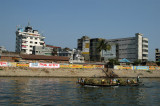 Along the river downstream from old Dhaka with what I believe is a textile factory