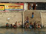 Bangladeshi men bathing along the ghat (the steps leading down to the river) Dhaka
