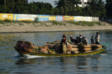 A boat fully laden with produced headed to market in Dhaka