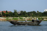 A small motorized dhow-type vessel, Bangladesh