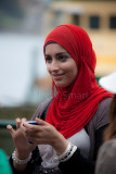 Young woman in hijab with mobile phone