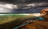 Bilgola Beach rockpool with approaching storm
