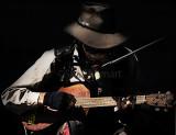 Country singer busker on guitar