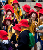 Red hatted schoochildren on outing