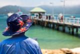 Man wearing Australian flag hat at Palm Beach Wharf